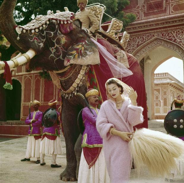 Anne Gunning in a Pink Mohair Coat outside the City PalaceJaipurIndiaVogueNovember,1956.jpg